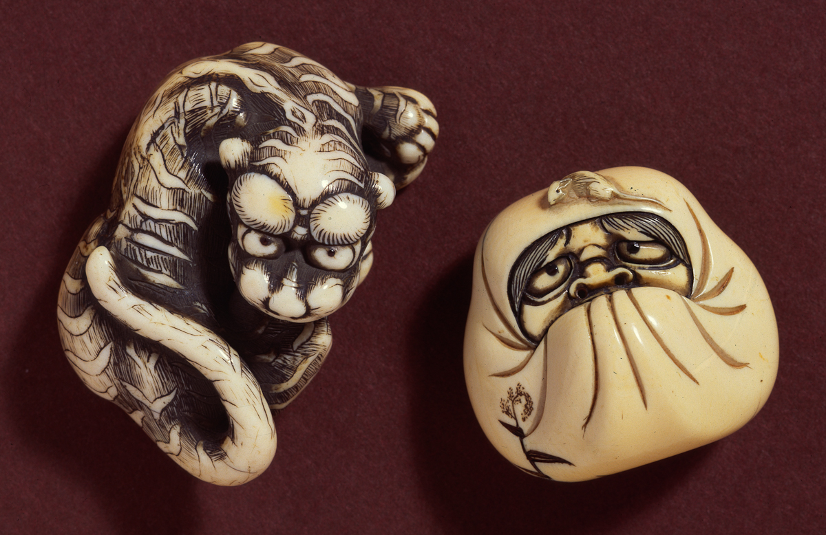 Daruma in meditation with rat crawling over his head
